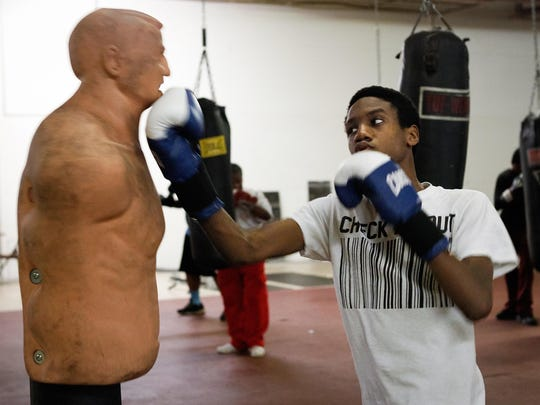 Colerain Township's Cameron Best, 15, throws an uppercut on a dummy at Real Deal Boxing Club, where members of Fighting Chance practice boxing and work on life goals.