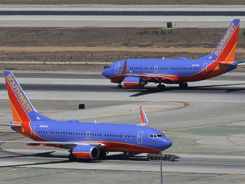 A Southwest Airlines Boeing 737 takes off as another taxis at Los Angeles International Airport. Southwest has had trouble with its on-time performance this year.