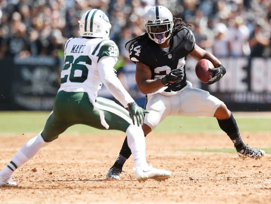 Oakland Raiders running back Marshawn Lynch (24) runs