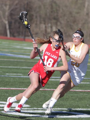 Action during a Section 1 girls lacrosse game between Mahopac and Fox Lane at Mahopac High School on Friday, April 15th, 2016. Mahopac won in overtime 9-8.