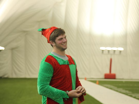 Quarterback Zach Mettenberger dressed up as an elf for the Titans family Christmas party.