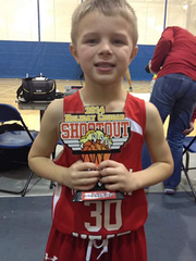 Brody Stephens with a basketball trophy before he was diagnosed with cancer for the second time.