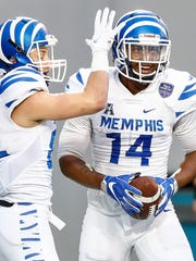 Memphis receiver Antonio Gibson (right) celebrates