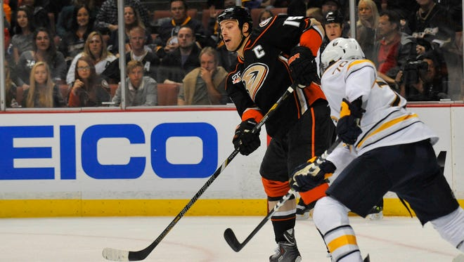 Anaheim Ducks center Ryan Getzlaf (15) clears the puck against the Buffalo Sabres during the first period at Honda Center on Friday. Getzlaf recorded the first three-goal hat trick of his career n the 6-2 win.
