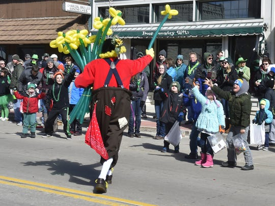 Door County clown Fred Wittig and his balloon flowers are popular to the parade crowd during St. Patrick's Day Parade in Sturgeon Bay on March 11. To see a video of the Wittig creating the flower balloons, click onto: www.doorcountyadocate.com. Tina M. Gohr/USA TODAY NETWORK-Wisconsin