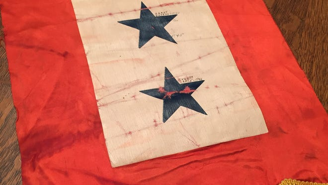 This World War II service flag was reunited with descendants of the family that once hung in the front window of their home.