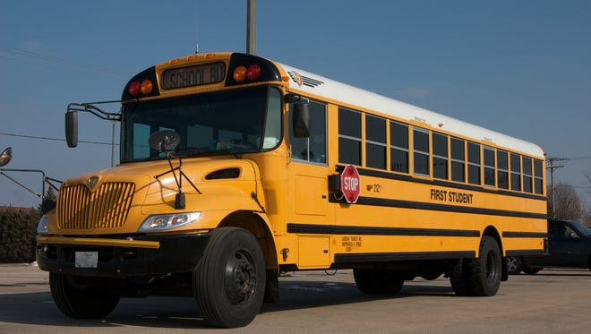 Pace area parents worry long school bus rides with multi-age students.