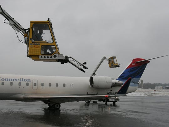 A plane gets de-iced at Westchester County Airport.