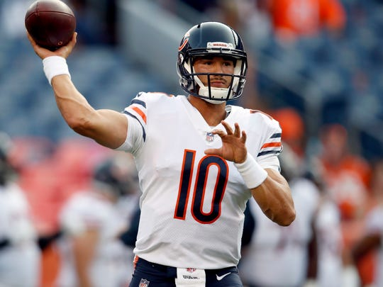 FILE - In this Saturday, Aug. 18, 2018, file photo, Chicago Bears quarterback Mitchell Trubisky (10) warms up prior to a preseason NFL football game against the Denver Broncos in Denver. As the Chicago Bears prepare for a primetime season opener against Aaron Rodgers and the rival Green Bay Packers, quarterback Mitchell Trubisky sees a team with no limits. The Bears come into the matchup at Lambeau Field on Sunday night, Sept. 9, 2018 with a decidedly different outlook after changing coaches, overhauling the receivers group and pulling off a huge trade last weekend to add two-time All-Pro Khalil Mack to their defense. (AP Photo/David Zalubowski, File)