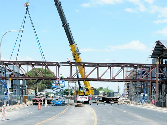 The steel beams are installed over El Paseo Road in July of 2014 for the new Las Cruces High School pedestrian bridge.
