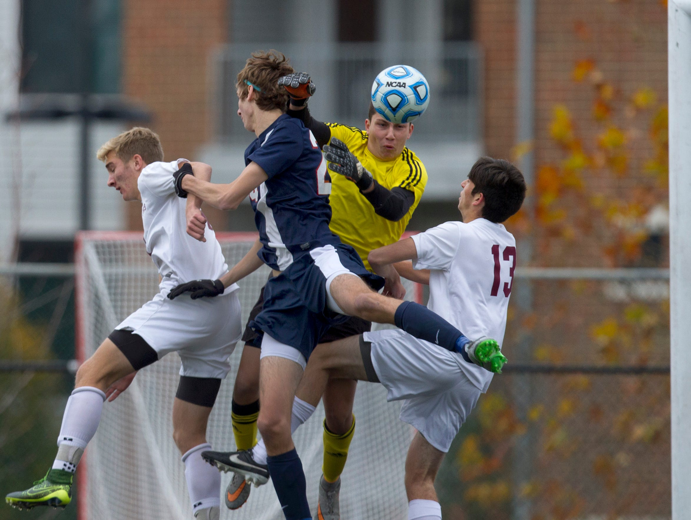 Toms River South goalie Dom Pizzi battles in front of goal during second half action. Toms River South Boys Soccer vs West Morris Mendham in NJSIAA State Group III Championship at Kean University on November 22, 2015 in Union, NJ.