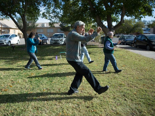 Steve Barowsky, tai chi instructor leads students in