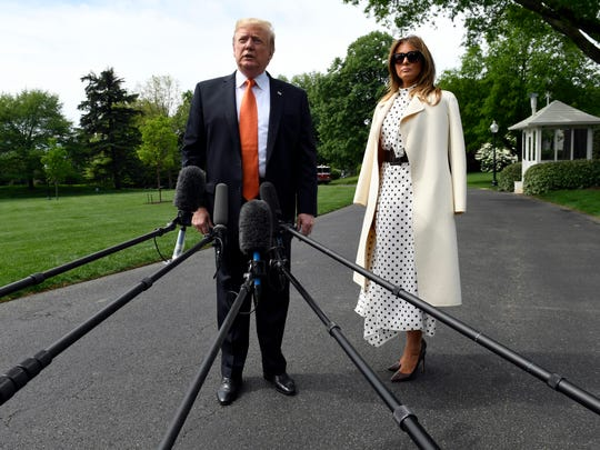 President Donald Trump, with first lady Melania Trump, talks with reporters on the South Lawn of the White House in Washington before boarding Marine One for the short trip to Andrews Air Force Base in Maryland. The Trumps are heading to Atlanta to speak at a drug abuse summit.