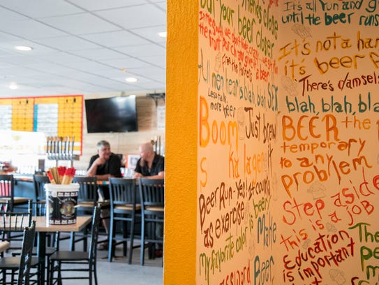 Quotations and sayings about beer adorn the walls at