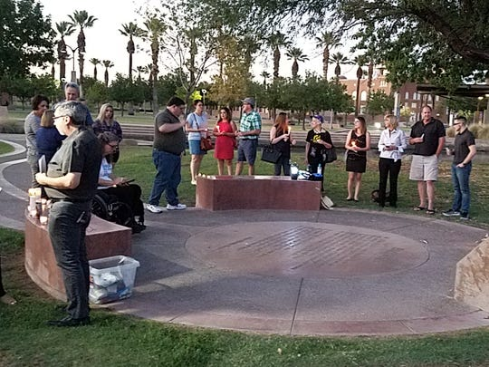 Attendees gather at a Phoenix vigil honoring the slain