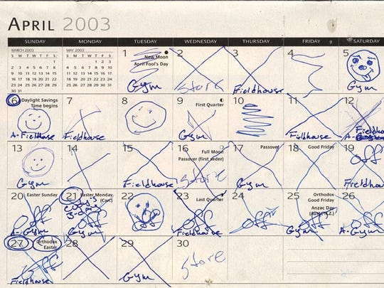 """The calendar used by Elmira prison inmates Timothy Vail and Timothy Morgan, who dug a hole through the ceiling of their cell to escape on July 7, 2003. The inmates explained that an """"X"""" was a day digging was done, a squiggly line meant no digging was done and a smiley face meant good progress was made. The inmates, who used bedsheets tied together to go over the four-story prison wall, were captured the next day. A prison report said lax oversight helped the inmates escape."""
