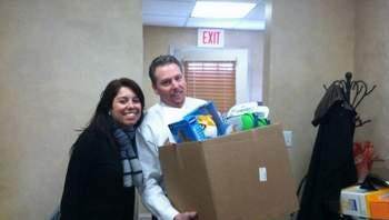 Christopher Moyes, President of Staffing Alternatives along with Monica Romano, Marketing Assistant, getting ready to deliver toys to the Child Life Programs of Robert Wood Johnson and St. Peters Hospital.