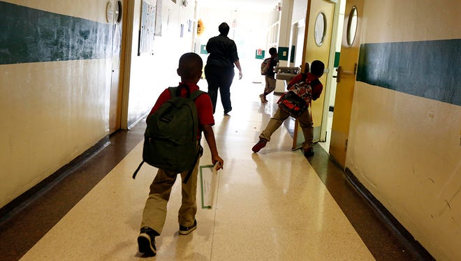 In this Oct. 23, 2014 photograph, students leave the elementary school wing at the Durant Public School in Durant, Miss. This K-12 school is one of many that have had to make tough economic cuts as the state funding formula, called the Mississippi Adequate Education Program, is continually underfunded by the state legislature.