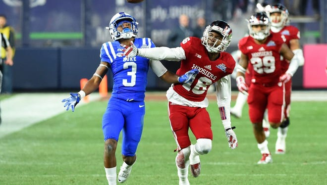 Dec 26, 2015; Bronx, NY, USA; Indiana Hoosiers defensive back Rashard Fant (16) breaks up a pass intended for Duke Blue Devils wide receiver T.J. Rahming (3) during the second quarter in the 2015 New Era Pinstripe Bowl at Yankee Stadium. Mandatory Credit: Rich Barnes-USA TODAY Sports