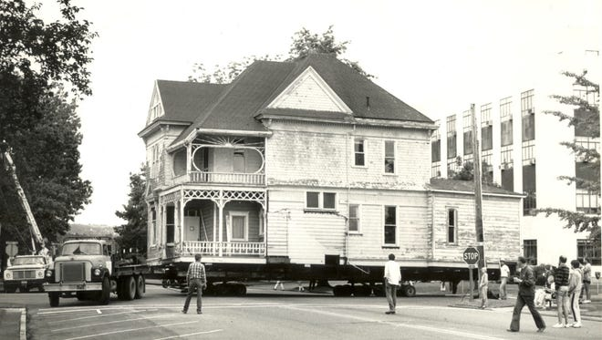 The Collins-Downing House as it is being moved on Chemeketa Street NE in Salem.