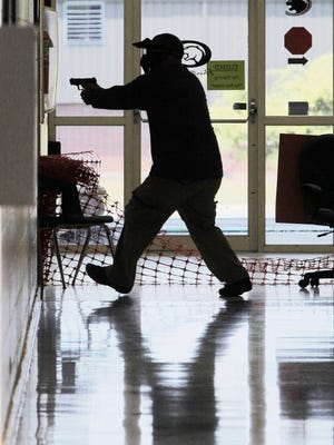 A faculty member participates in active-shooter training at the public high school in Clarksville, Ark., July 11, 2013.