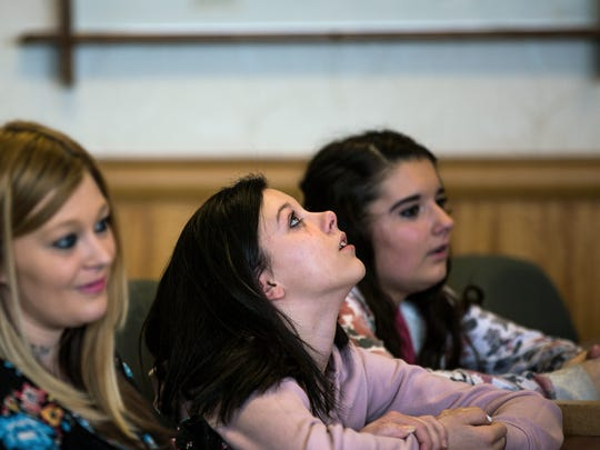Julie Straw, left, the mother of Jayda Morrison, center, Daniel Martz's daughter, and Maryah Ferk, Martz's niece, react as the judge sentences Kyle Keding to three years in prison and five years on probation at the Wood County Courthouse in Wisconsin Rapids, Wis., Monday, February 5, 2018.