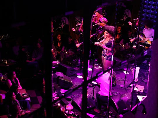 Wé McDonald is reflected in a mirror, as she performs at Joe's Pub, in New York City, Saturday, April 7, 2018.