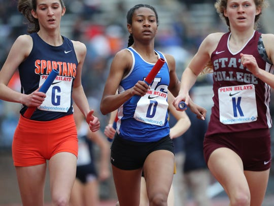 Leena Morant (D), of Union Catholic, runs the second leg of the 4x800.  She finished her leg with a time of 2:13.16. Catholic finished with an overall time of 9:10.4. Friday, April 27, 2018