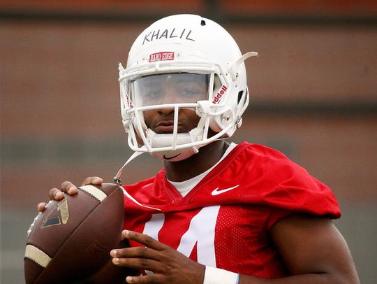 Quarterback Khalil Tate practices on Monday at Sancet
