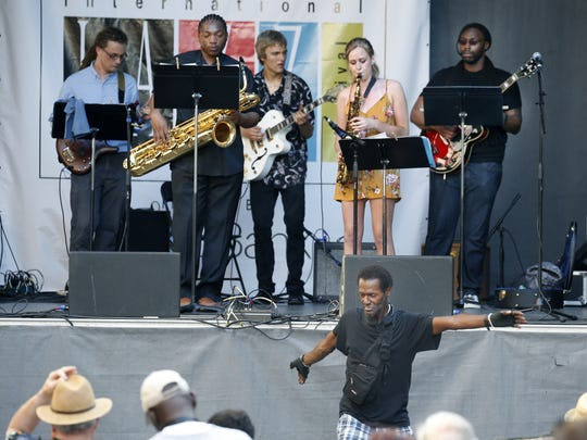 Ralph Nathan of Rochester dances to the tunes of the MCC Jazz Band during the Xerox Rochester International Jazz Festival.