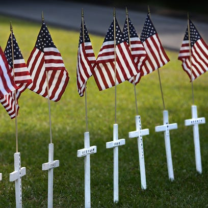 Crosses representing lives lost in each of America's