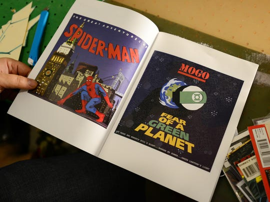 Casey Ocupe shows some of the comic books he's collected