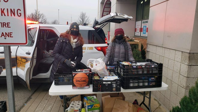 Police and firefighters gathered donations of toys, clothes and food at the Zeeland Family Fare on Saturday, Dec. 19 for Harvest Stand Ministries.