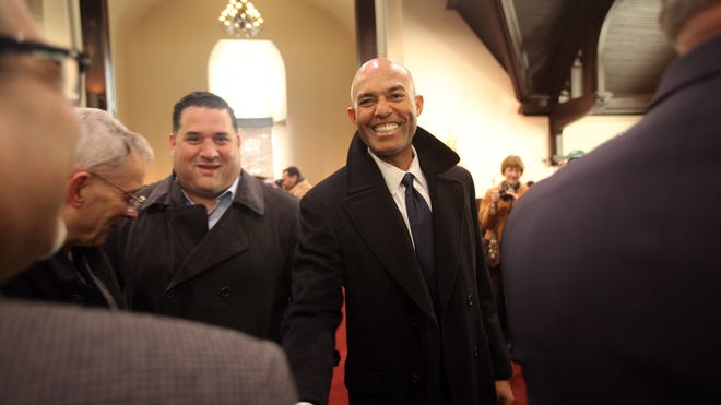 Former Yankees star Mariano Rivera greets people at the Refuge of Hope Church in New Rochelle on March 6, 2014. Rivera and his wife, Clara help restore the church after it was abandoned in the 1970s. Clara Rivera leads the ministry.