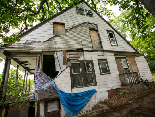 A portion of the $37 million the Des Moines could get from a 1-cent sales tax increase would go toward removing blighted homes like this one in the River Bend neighborhood.
