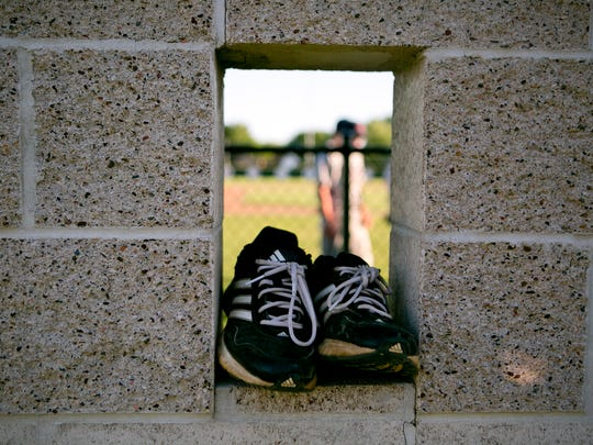 Shoes sit in the Chaparrals dugout during the baseball game against the Eau Claire Cavaliers at Jack Hackman Field in Marshfield, Wednesday, July 9, 2014.
