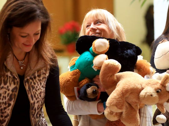 Advocate Sue Gray (right) from the Women's Shelter of South Texas holds stuffed animals as she prepares to package them after they were collected by American Bank on Thursday, Jan. 5, 2016, at its Southside location in Corpus Christi. More than 700 teddy bears and stuffed toys will be given to victims of crime and children in the Women's Shelter of South Texas and the Nueces County Court-at-Law No. 5.