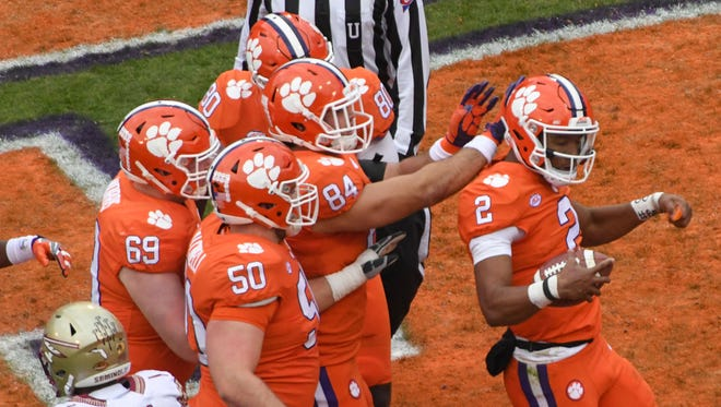 Clemson quarterback Kelly Bryant(2) celebrates after scoring against Florida State during the first quarter in Memorial Stadium at Clemson on Saturday.
