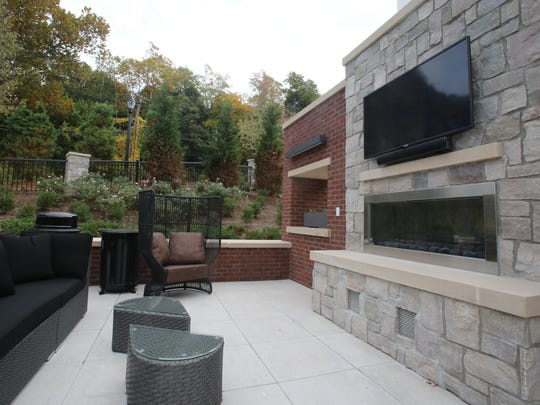 A view of the outdoor tv and fire pit lounge at Quarry apartments in Tuckahoe Oct. 19, 2016.