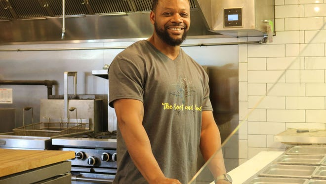 Christian Buze is the owner of the Root and Soul at DeSoto Central Market.