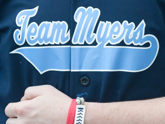Matthew Myers of Haddon Township wears a baseball jersey and bracelets in honor of his father, Rich Myers.