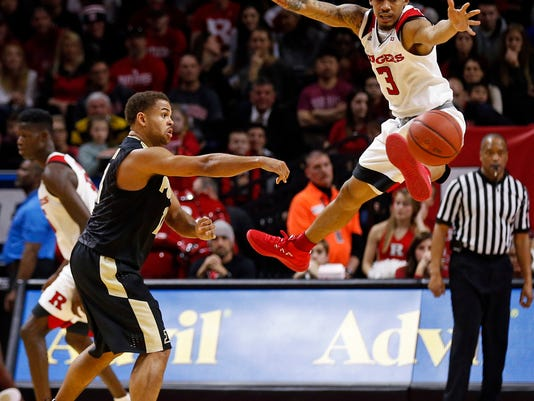 Purdue guard P.J. Thompson, front left, passes around Rutgers guard Corey Sanders (3) during the second half of an NCAA college basketball game Saturday, Feb. 3, 2018, in Piscataway, N.J. (AP Photo/Adam Hunger)