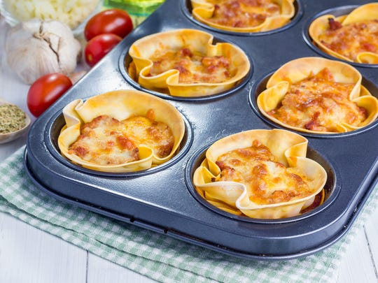 Homemade lasagna cups with minced meat, bolognese sauce, topped with cheese.