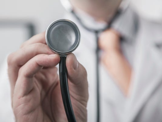 Close up of male doctor holding a stethoscope