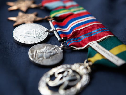 0128389012-THINKSTOCK-PHOTOS-PEACE-MEDALS