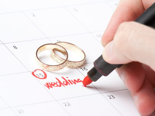 A person marking off their wedding date in the calendar