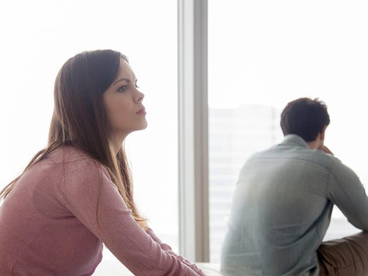 Unhappy couple ignoring each other after argument, problems in relationship