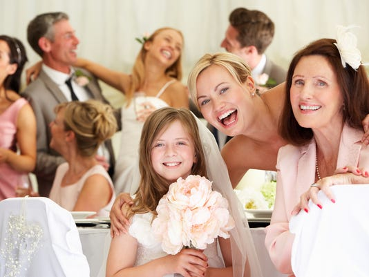 Smiling bride with relatives and guests at wedding