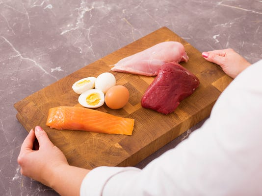 Woman getting ready to prepare nutritious dinner