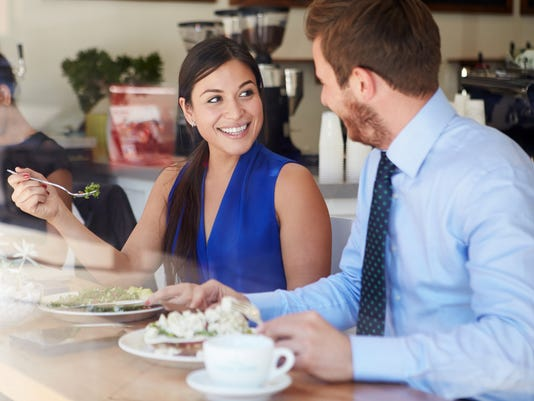 Two Businesspeople Meeting For Lunch In Coffee Shop
